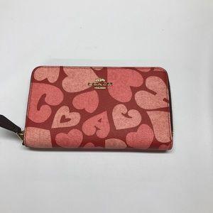 Coach medium zip wallet. NWT